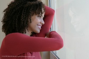 Woman looking out window.Huff Post 2